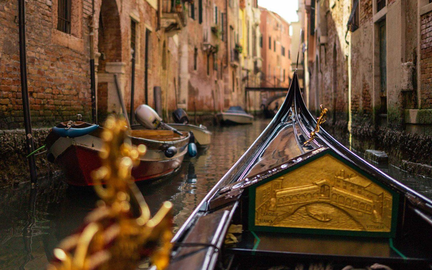 gondola riding through canal in venice